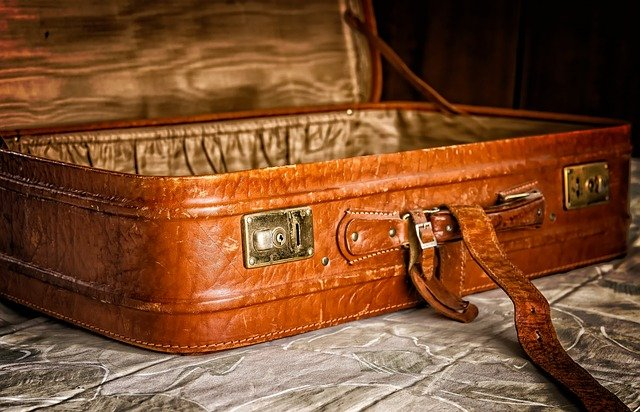 A piece of luggage sitting on top of a suitcase
